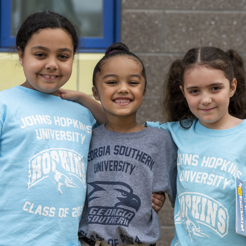 Three Alma del Mar Scholars in their College T-shirts