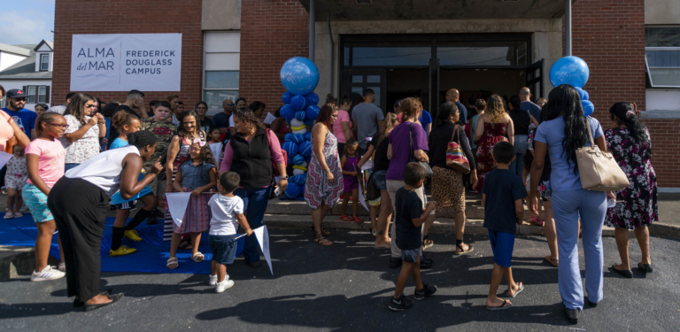 panoramic image of families entering Frederick Douglass campus for the first time
